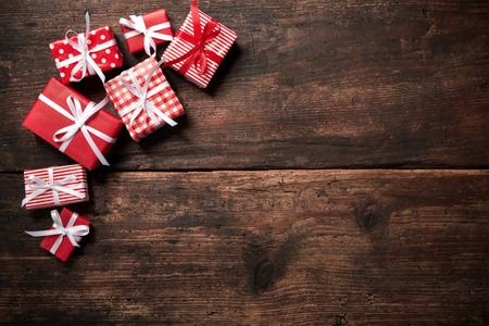 Photo for Gift boxes over dark wooden background - Royalty Free Image
