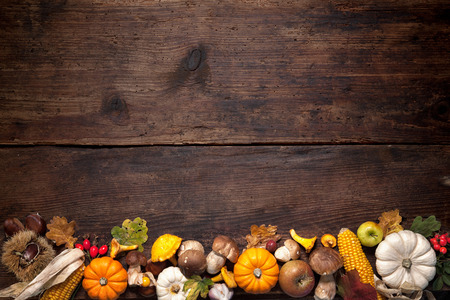Foto de Harvest or Thanksgiving background with autumnal fruits and gourds on a rustic wooden table - Imagen libre de derechos