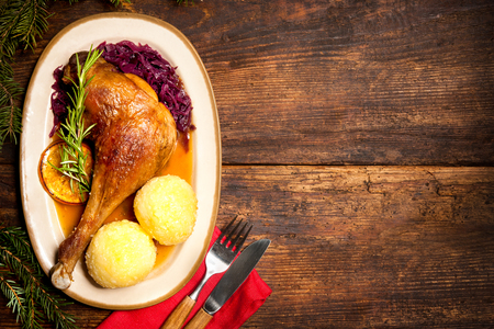 Photo for Crusty goose leg with braised red cabbage and dumplings. Cooking at Christmas time - Royalty Free Image