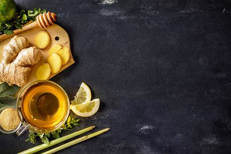 Photo for Cup of ginger tea with lemon and honey on slate plate - Royalty Free Image