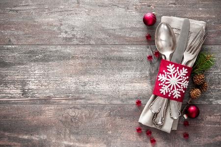 Foto de Christmas table place setting. Holidays background - Imagen libre de derechos