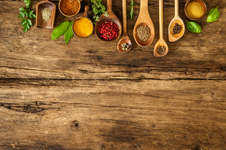 Foto de Various colorful spices on wooden table - Imagen libre de derechos