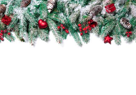 Photo for Christmas Border. Tree branches with baubles, stars, snowflakes isolated on white - Royalty Free Image