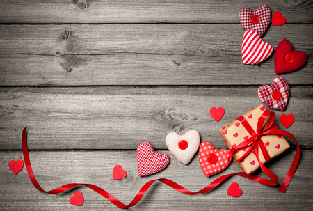 Photo for Valentines day vintage background with hearts and a gift box on wooden board - Royalty Free Image
