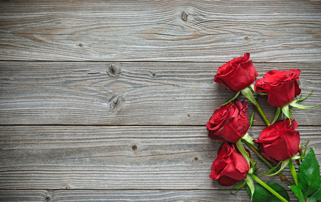 Photo for Red roses on wooden board, Valentines Day background - Royalty Free Image