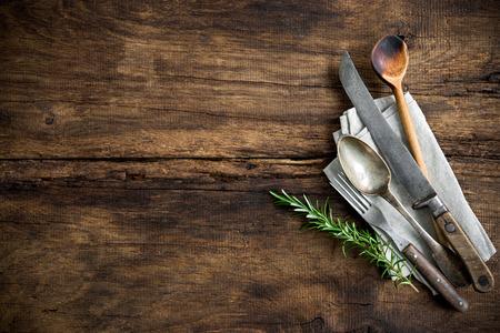 Photo pour vintage kitchen utensils on wooden table - image libre de droit