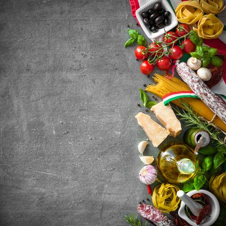 Foto de Italian food ingredients on slate background - Imagen libre de derechos
