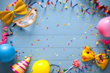 Foto de Colorful birthday frame with party items on blue background. Happy birthday concept - Imagen libre de derechos