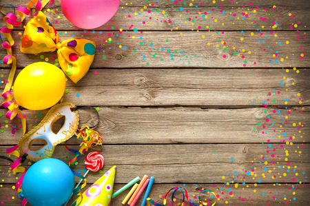Photo for Colorful birthday or carnival frame with party items on wooden background - Royalty Free Image
