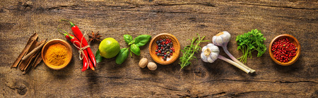 Photo pour Various herbs and spices on wooden table - image libre de droit