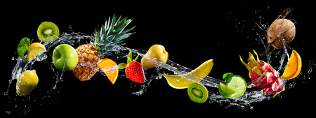 Photo for Fruits on black background with water splash - Royalty Free Image