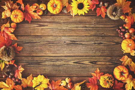 Photo for Vintage autumn border from fallen leaves and fruits on the old wooden table. Thanksgiving autumn background - Royalty Free Image