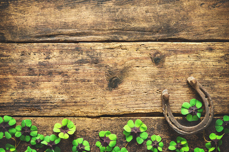 Photo for St. Patrick's day, lucky charms. Horseshoe and shamrock on wooden background - Royalty Free Image