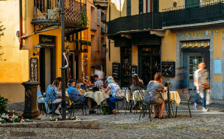 Photo for Tourists sitting at a cafe - Royalty Free Image