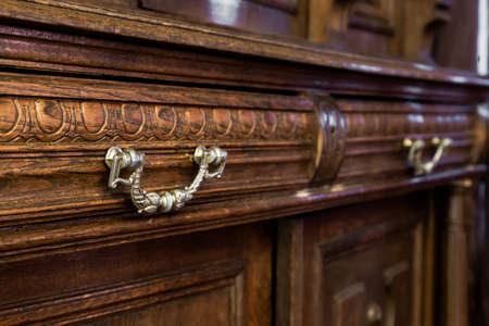 Foto de antique wood dresser with vintage furniture - Imagen libre de derechos