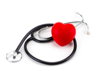 Foto de Red heart and a stethoscope isolated on white background. - Imagen libre de derechos