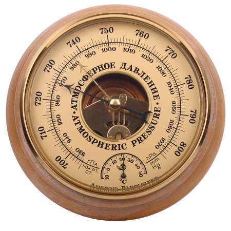 Photo pour Old yellow-brown aneroid barometer in wooden body is isolated on a white background - image libre de droit