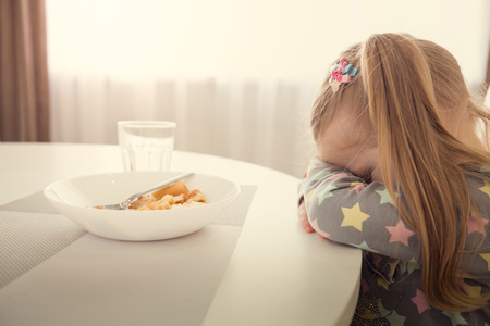 Foto per Little girl refuses to eat. Child meal difficultes theme. - Immagine Royalty Free