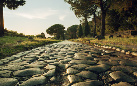 Photo for Antique road , Via Appia Antica in Rome, Italy on sunset - Royalty Free Image