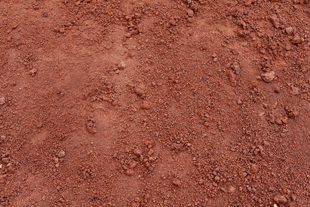 Photo pour Red Soil Tropical laterite soil or red earth background. Red mars sand background. Top view - image libre de droit