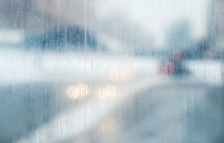 Foto de close up view of a distinctly dirty window showing, grime, streaks and opacity blurred background - Imagen libre de derechos