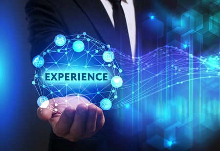 Photo pour Business, Technology, Internet and network concept. Young businessman working on a virtual screen of the future and sees the inscription: Experience - image libre de droit