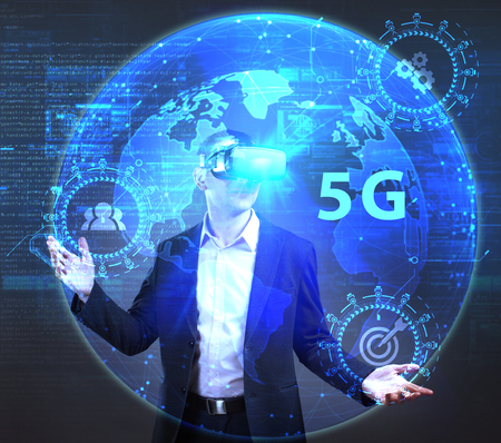 Photo pour The concept of business, technology, the Internet and the network. A young entrepreneur working on a virtual screen of the future and sees the inscription: 5G - image libre de droit