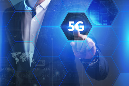 Photo pour Business, Technology, Internet and network concept. Young businessman working on a virtual screen of the future and sees the inscription: 5G - image libre de droit