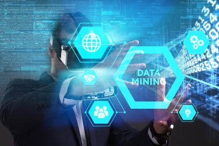 Foto de Business, Technology, Internet and network concept. Young businessman working in virtual reality glasses sees the inscription: Data mining - Imagen libre de derechos