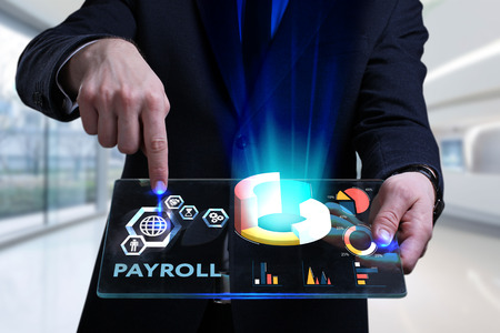 Foto de Business, Technology, Internet and network concept. Young businessman working on a virtual screen of the future and sees the inscription: Payroll - Imagen libre de derechos