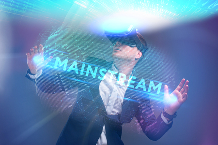 Photo for Business, Technology, Internet and network concept. Young businessman working in virtual reality glasses sees the inscription: Mainstream - Royalty Free Image