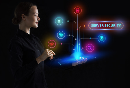 Foto de The concept of business, technology, the Internet and the network. A young entrepreneur working on a virtual screen of the future and sees the inscription: Server security - Imagen libre de derechos