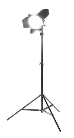 Foto de Studio lighting on a tripod stand, isolated on a white background. Professional studio equipment. Searchlight for cinema. Making movie single icon in black style bitmap. - Imagen libre de derechos