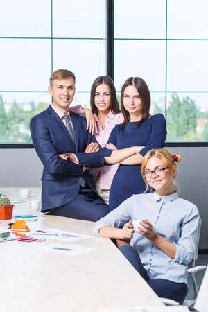 Photo for Team of business, friendly office workers in a working office premise - Royalty Free Image