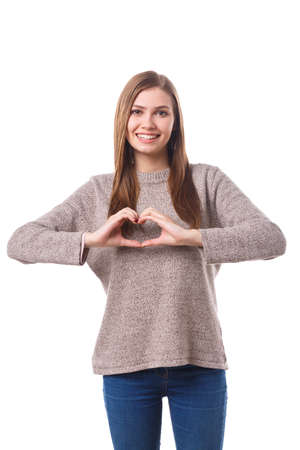 Photo for A charming girl showing a gesture of the heart. Isolated on white background. - Royalty Free Image