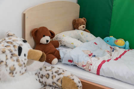 Photo pour Nursery for toddlers with cozy blanket and plush toys - detail - image libre de droit