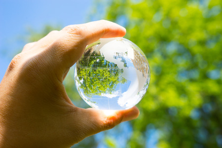 Photo for Green & Eco environment, glass globe in the garden - Royalty Free Image