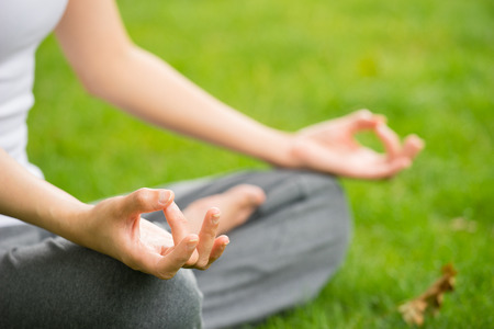Photo for woman meditating and Yoga in a park - Royalty Free Image