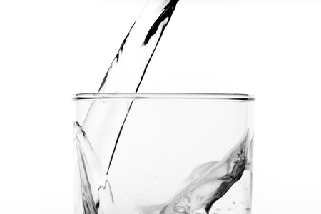 Photo for Glass of water with pouring from the bottle, studio shot - Royalty Free Image