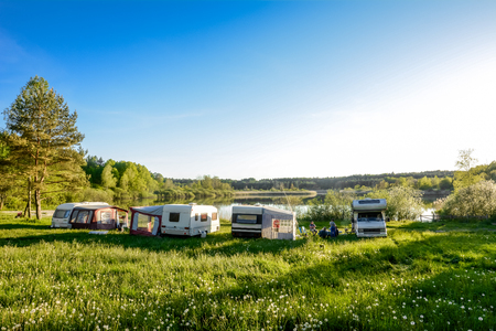 Foto de Caravans and camping on the lake. Family vacation outdoors, travel concept - Imagen libre de derechos