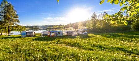 Photo for Family travel concept. Caravans and camping on the lake. - Royalty Free Image