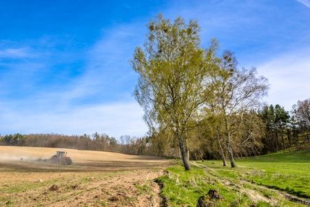 Photo pour Tractor on field, agriculture and crop in spring, farm land landscape - image libre de droit