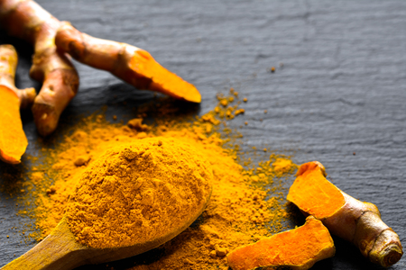 Photo for Fresh root and turmeric powder, indian spice, healthy seasoning ingredient for vegan cuisine - Royalty Free Image