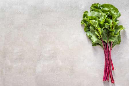 Foto de Green beet leaves or swiss chard. Fresh farm vegetable leafs, top view - Imagen libre de derechos