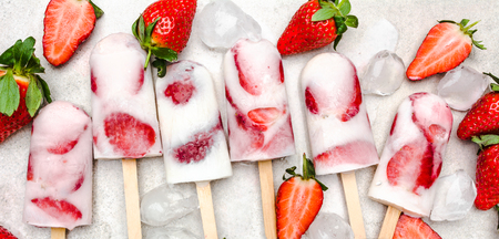 Photo for Fresh strawberry popsicles. Juicy ice cream with fruit, food for refreshing in the summer. - Royalty Free Image