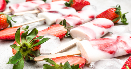 Photo for Fresh fruit ice lolly. Strawberry ice cream frozen with berry and yogurt. - Royalty Free Image
