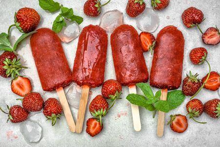 Photo for Homemade popsicles with fruits. Strawberry ice lollies on sticks, top view, flat lay - Royalty Free Image