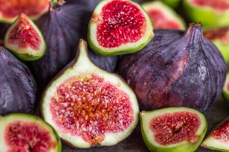 Photo for Fresh juicy figs fruit. Fig slice, closeup. - Royalty Free Image