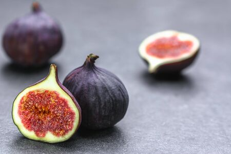 Photo for Fresh fig fruit. Blue figs on dark background. - Royalty Free Image