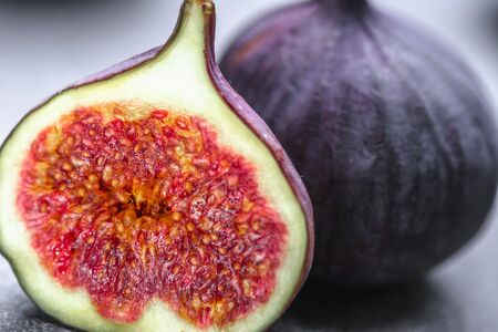 Photo for Fresh figs. Purple slice of fig fruit, closeup - Royalty Free Image